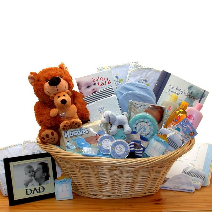 The Deluxe Welcome Home Precious Baby Basket delivers all sorts of baby's firsts including a first teddy bear, a first tooth keepsake box, and a first haircut keep sake box. This large laundry basket