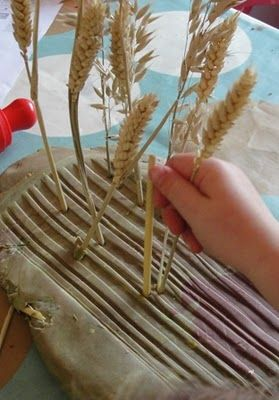 play dough with crops for harvesting, what I love best about this picture and this activity is the large amount of dough and  the natural materials that the children are using, never forget that nature is important!