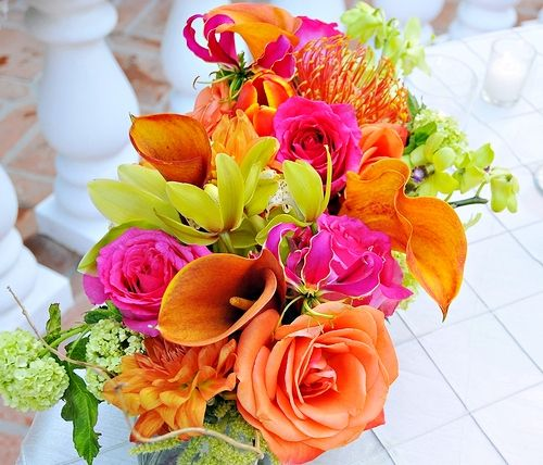Use the ceremony flowers at your reception as well. One caution: There may be a slight up-charge if you'd like the florist to transport and set up the ceremony flowers at the reception site. However, sometimes this is far lower cost than purchasing flowers for two separate locations. Of course, you could also ask a friend to be in charge of transporting the flowers and setting them up.  Read More http://morefemale.com/how-to-plan-a-wedding-the-flowers-part-2/