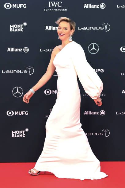 Princess Charlene of Monaco dazzled in Stella McCartney One-shoulder stretch-cady gown, made a statement with a bold glossy red lip, and very modern dyed hair with an asymmetric style, walks on the red carpet before the 2018 Laureus World Sports Awards ceremony at the Sporting Monte-Carlo complex in Monaco