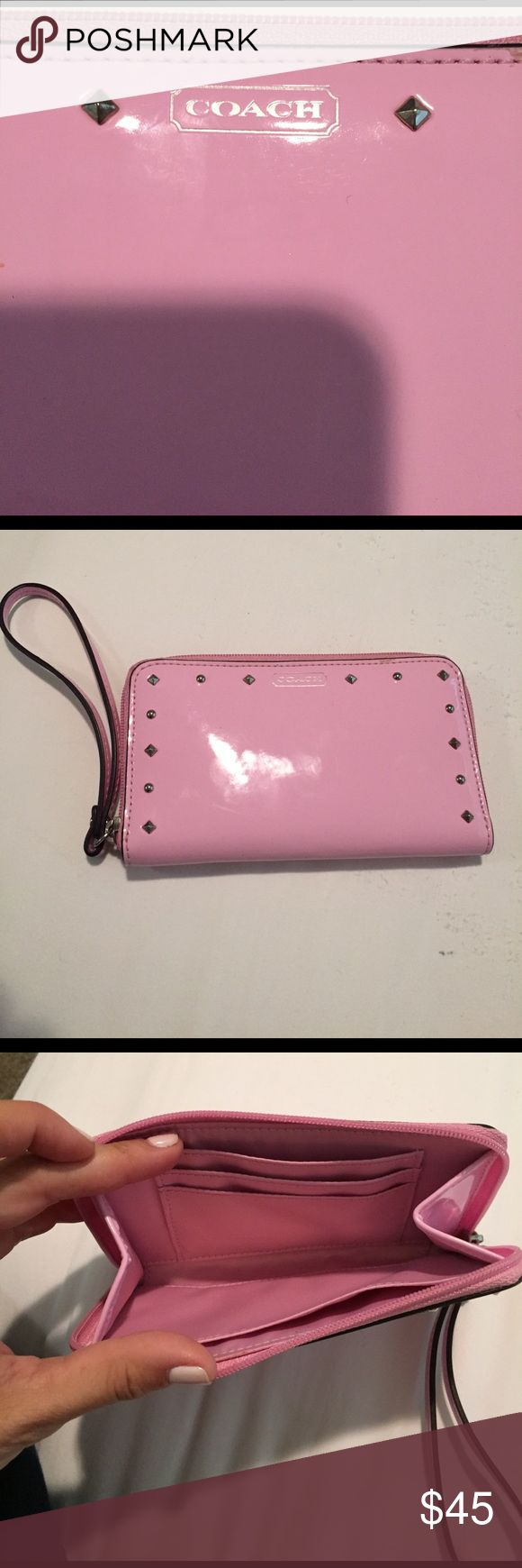 Coach wristlets/ wallet Coach wristlet/ wallet Pink with silver grommets. Excellent condition used maybe twice. Coach Bags Clutches & Wristlets
