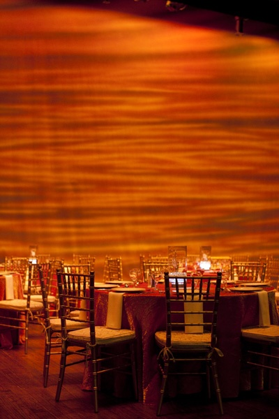 Dinner on stage of the Theatre using a sunset backdrop to tie in the theme