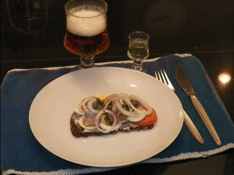 Smørrebrød- Learn to make a Danish Herring (Sild) Open Face Sandwich. Check out our video to see how to make this classic open sandwich!