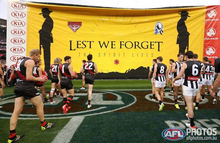 Round four - Essendon and Collingwood players run through a joint banner on Anzac Day