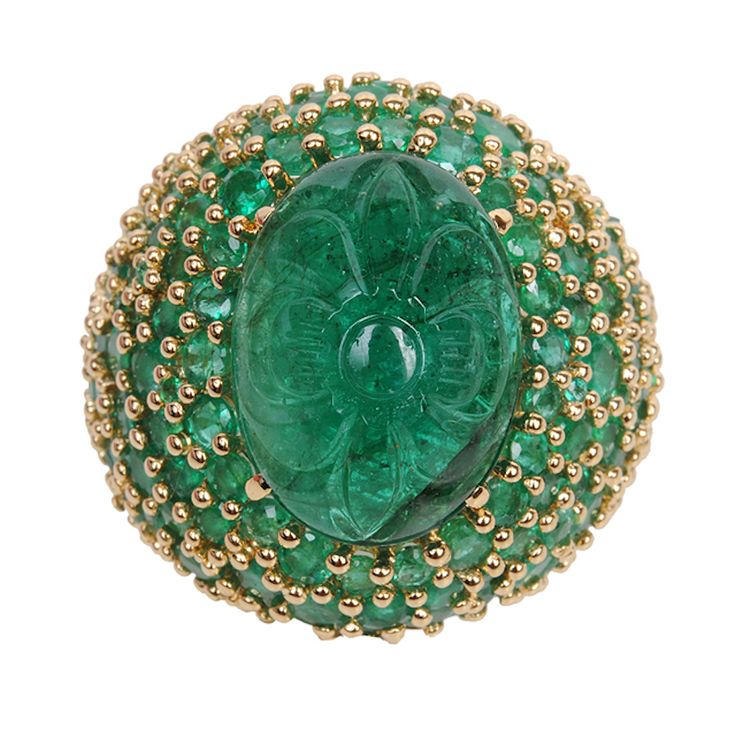 Breathtaking 18k yellow gold ring featuring a large carved emerald center stone and round green emerald faceted stones surround.