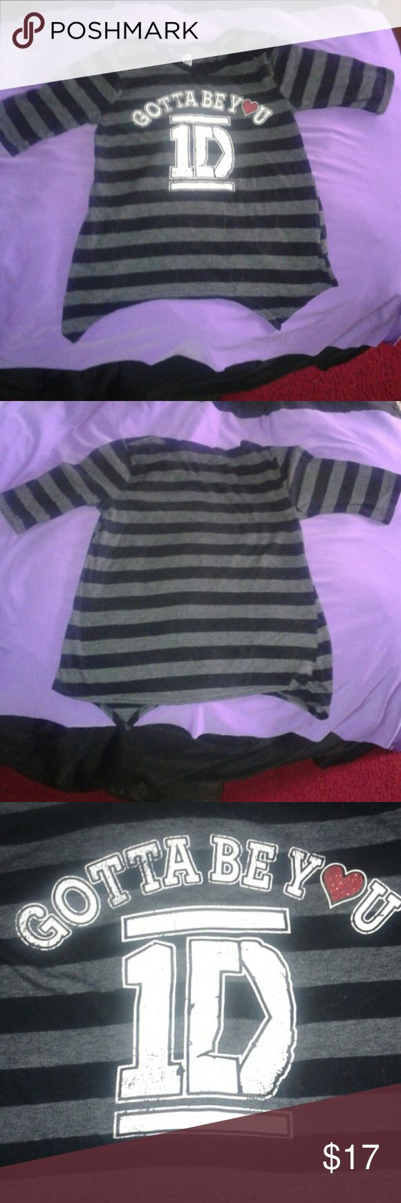 One Direction Black & Gray Shirt Sz XL (14/16) Cute One Direction black and gray stripe shirt. Top 75% cotton & 25% polyester. Size XL (14/16). Neckband 100% cotton. It's been washed but there is lint all over the shirt. On the front bottom has two points design and the back doesn't. One Direction Shirts & Tops Tees - Short Sleeve