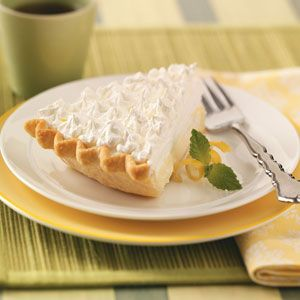 Sour Cream-Lemon Pie Recipe -I first tasted this pie at a local restaurant and hunted around until I found a similar recipe—now it's my husband's favorite.