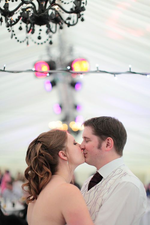 newly married couple having their first kiss.
