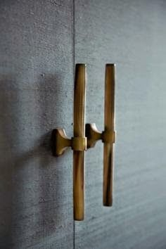 handcrafted and modern at the same time.  Strong brass pulls