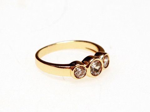 Three Stone Rubover Gold Ring: Timeless sparkles of this classically-shaped ring ensure its great compatibility with any other jewellery box items. $25.00