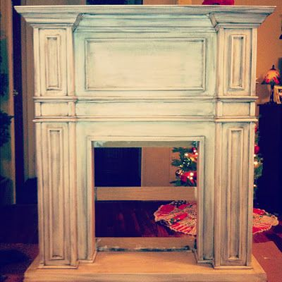Build a fake fireplace mantle for the living room - I love this!