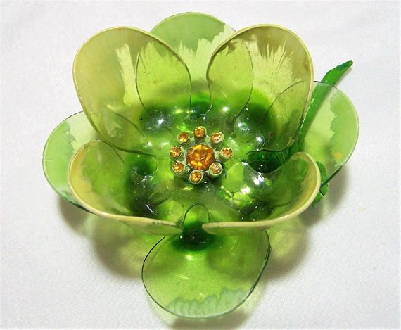Mid Century lucite or cellulose acetate floral brooch (most likely the latter) Gorgeous olive green petals with light green painted highlights, golden rhinestones in the ce... #gotvintage