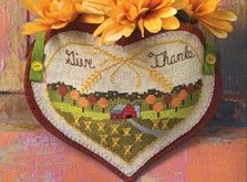 """Give Thanks Appliquéd Heart Pocket-Add color and charm to your Thanksgiving décor with this beautiful heart-shaped pocket- with Crossstitch pattern Materials: pattern-available Wichelt Imports Lambswool 28-count Linen, 10""""x8"""" DMC 6-strand Embroidery Floss: as listed on key; (#3033) Very Light Mocha Brown National Nonwovens Rust Polynesian Sunset Woolfelt, 9""""x12-1/2"""""""