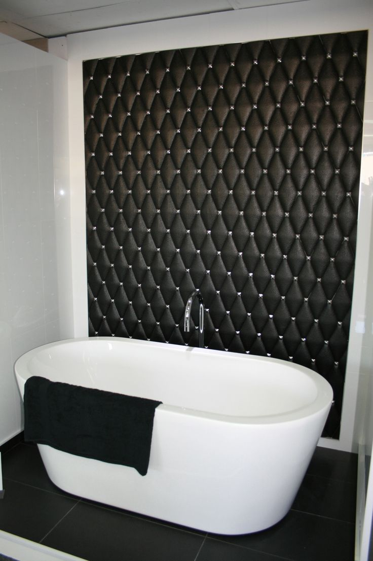 Black leather effect ceramics forming feature wall. Looks just like luxury leather padded wall!