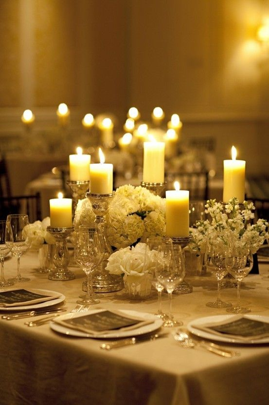 white low centerpiece with varied height candles - elegant and refined
