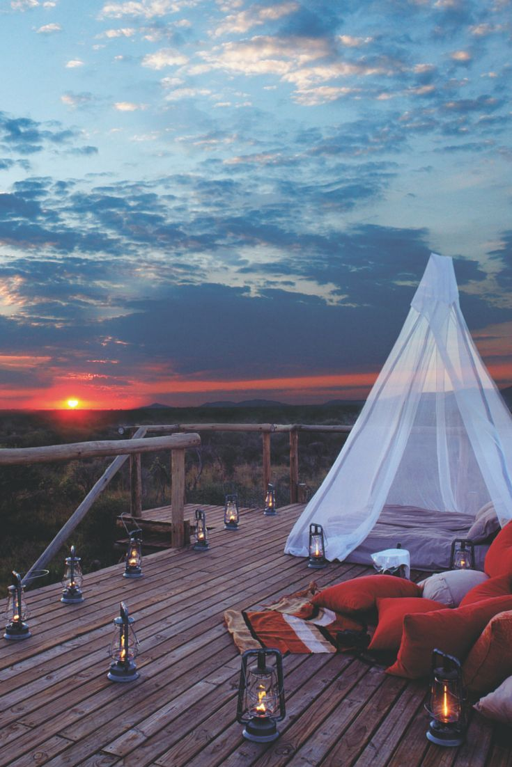 South Africa Travel Inspiration - Glamping under the stars in South Africa's Madikwe Game Reserve with Sanctuary Makanyane Safari Lodge.