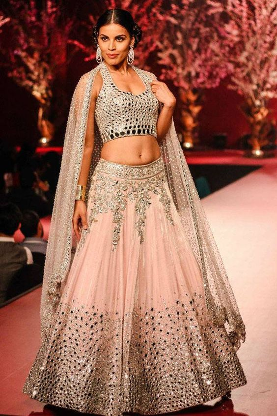 Light Pink Manish Malhotra Creation with silver gota work and mirror work paired with a gorgeous embroidered dupatta| light colourful lehengas for indian brides | sangeet, mehendi and wedding outfit ideas | LFW | Every Indian bride's Fav. Wedding E-magazine to read. Here for any marriage advice you need | www.wittyvows.com shares things no one tells brides, covers real weddings, ideas, inspirations, design trends and the right vendors, candid photographers etc.