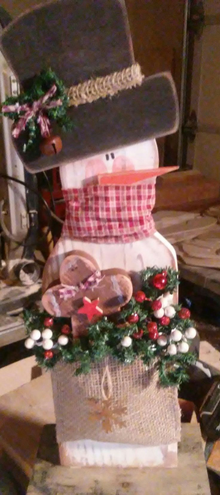 Country primitive snowman with burlap bag filled with goodies. Made from cedar fence post. Shelf sitter. Handmade, craft wood, rustic country primitive decor.