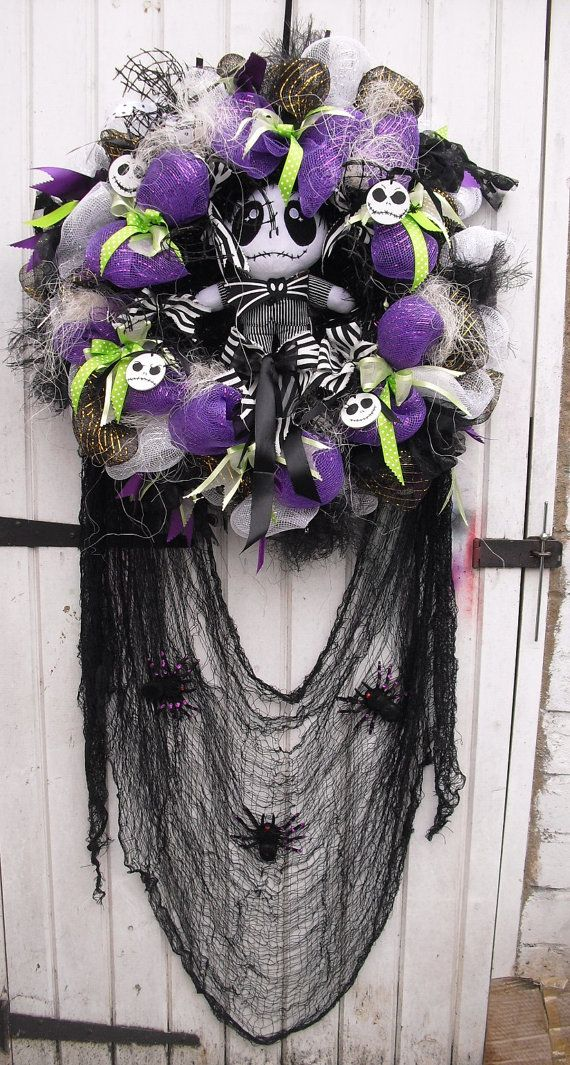 App.25 width - Halloween wreath Nightmare Before Christmas inspired  Much richer/nicer in real than at my pictures, many fantastic details are not visible or looks small/almost invisible. Im not a photographer.  Black tinsel covered wreath base plus a lot of decorative floristry mesh in purple, black and white,green ribbons, stiff black fish net decoration, 4 handmade plaques with Jacks faces and app. 10 soft Jack toy in the centre, 3 fake spiders at creepy cloth, wonderful fake spider…