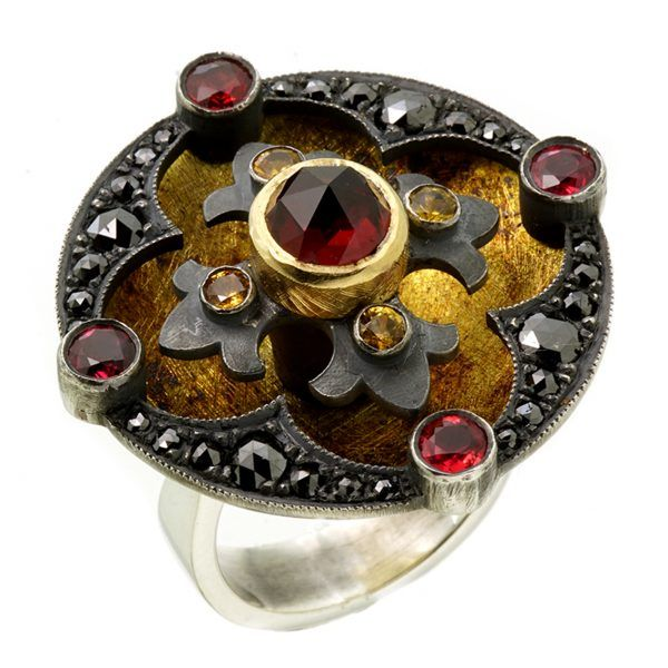 Luxurious 18ct yellow gold, sterling silver, rose cut garnet, yellow sapphires, red sapphires, black diamonds. Metal Couture.
