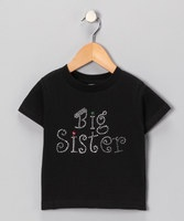 What better way for your little lass to broadcast her proud sister status than through this trendy tee? With a classic black hue, cozy cotton and sparkled slogan, this tee is as awesome as the announcement it proclaims!100% cottonMachine wash; hang dryImported