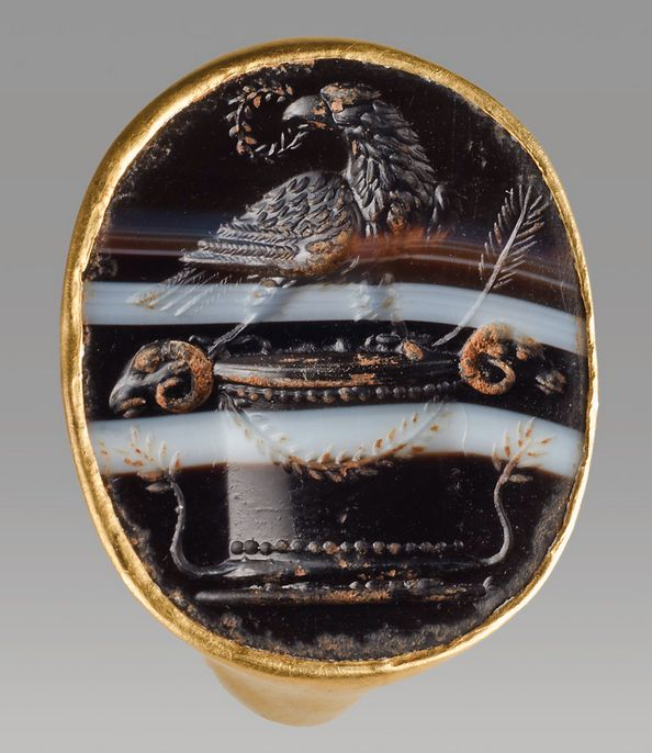 Gold and Banded Onyx Ring Depicting the Eagle of Rome, 1st Century ADThis ring is a particularly fine example of a form known across the Roman empire. The black-and-white banded onyx intaglio depicts the eagle of Jupiter with a wreath in its beak on...