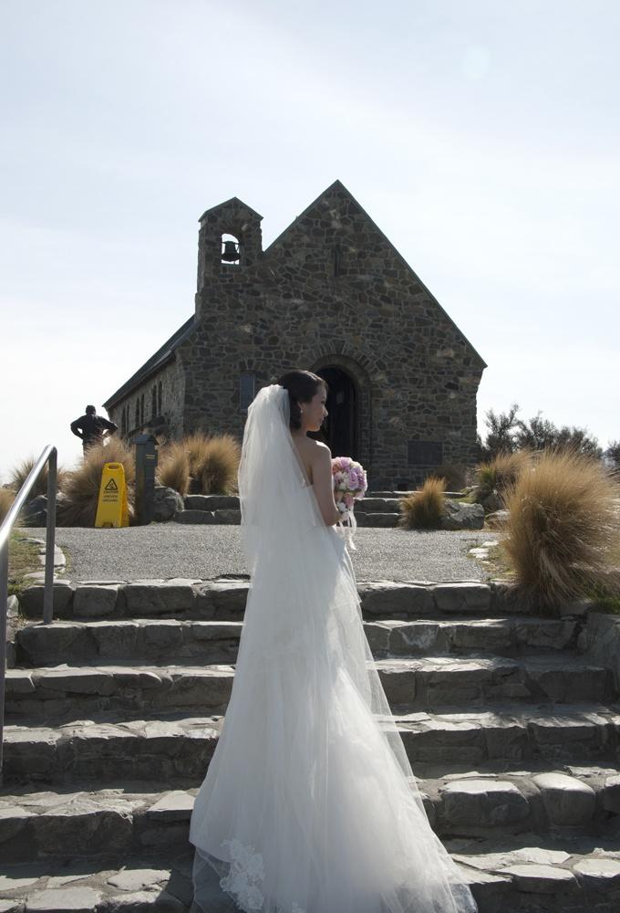 Bride outside the Church of the Good Shepherd at Lake Tekapo New Zealand