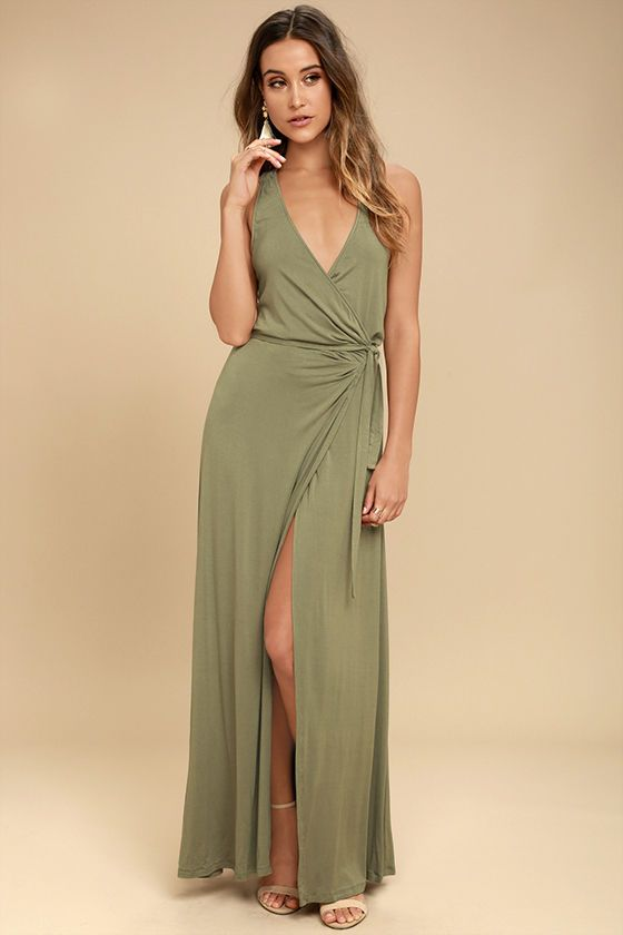 The Road to Rome Washed Olive Wrap Maxi Dress is a true bella! Soft, medium-weight jersey knit starts at tank straps, and carries into a wrapping bodice with tying sash belt. Wrapping detail carries into the front slit of the maxi skirt.