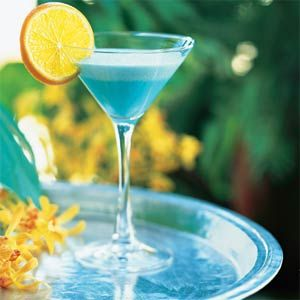I like my drinks to match my decor, sad but true    1 cup crushed ice   1/4 cup vodka  1/4 cup blue curaçao   1/4 cup whipping cream   2 tablespoons vanilla-flavored syrup (such as Torani)   2 tablespoons fresh orange juice  1 tablespoon Cointreau or other orange-flavored liqueur