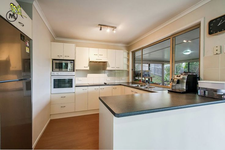 Loving the dark benchtops and white cupboards #kitchen #forSale