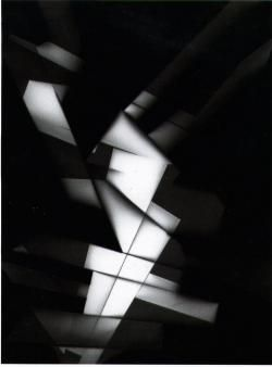 """Markus Amm 1999 Photogram on fiber based paper 24 x 18 cm In his Untitled series, Markus Amm revives the technique of the photogram. Pioneered as an art form by Man Ray and Moholy Nagy (the latter of which coined the term """"photogram""""), the process utilises rudimentary photograph principles: objects are placed on a photosensitive surface, and briefly exposed to light to create an abstracted """"x-ray"""" image, an inverted shadow outline of suggestive form."""