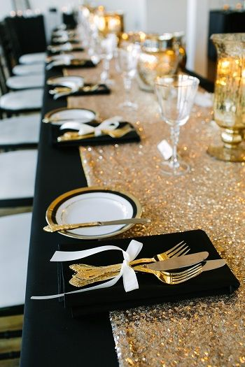 black and gold themed wedding reception table-where are the flowers?