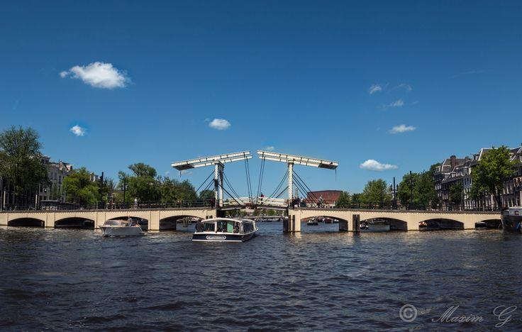 #Amsterdam #River Amstel #Magere brug #Skinny bridge #Netherlands #River #clouds #water #Boats #Architecture #Bridge