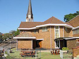 NG gemeente Port Natal - Die kerklike geboue van die gemeente in 1952. Hendrik Vermooten was die argitek van die kerkgebou, waarvan die hoeksteen op 11 Oktober 1947 gelê is.