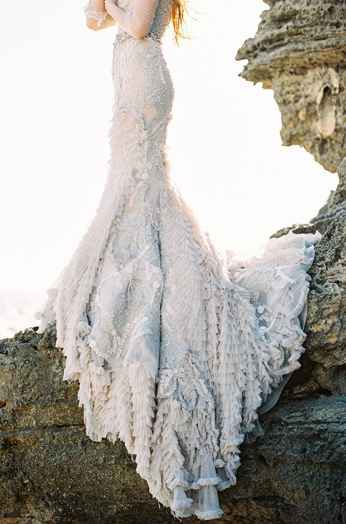 This wedding dress is so pretty! I love the details on the dress and I adore the color!