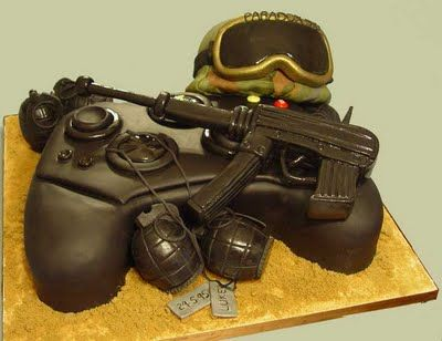 probably one of the awesomest cakes a gaming person could ever receive! it's an xbox controller with probably Call of Duty items surrounding