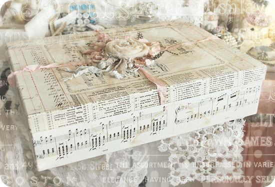 Handcrafted altered box, embellished with vintage sheet music, ephemera, ribbons, fabric rosette, and feathers