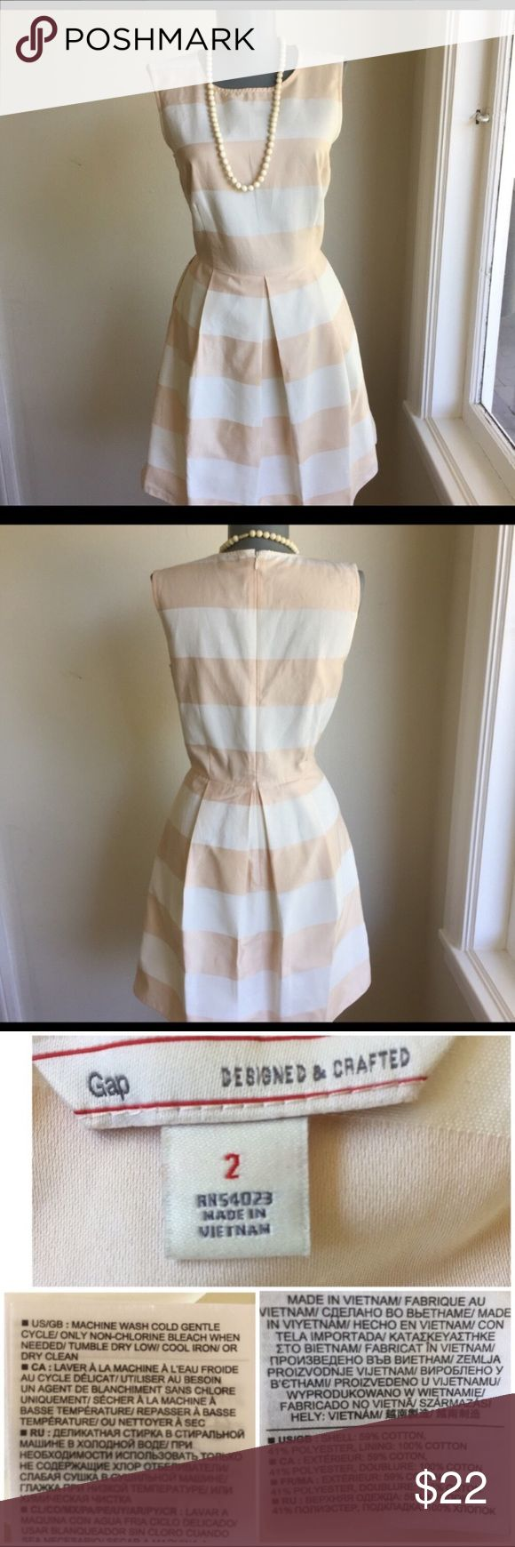 """Gap Light Peach and Off White Stripe Size 2 Dress. Gap Light Peach and Off White Stripe Size 2 Dress.  Fitted Top with 3 1/2"""" Pleats in Skirt for an Perfect Summer Look.  Flat lay measurements. Between underarms 17 1/2"""". Waist 14 3/4"""". Waist to hem 18"""". Very good condition.  So Pretty.  •••••This is a FIRM PRICE•••••••• GAP Dresses Mini"""