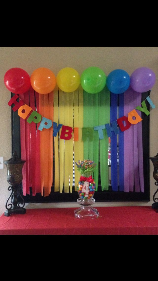Rainbow birthday decorations. Streamers and balloons!