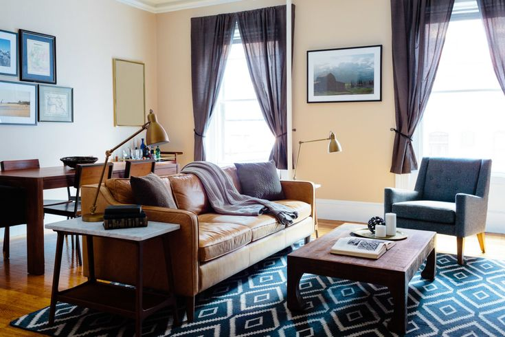 """For a young guy fresh out of grad school, Homepolish's Shannon Tate took a bare bones 1-bedroom apartment and transformed it into a modern take on the """"old gentlemen's club."""""""