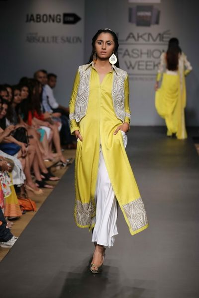yellow suit with front slit and white trousers  #punjabidesignersuits #punjabisuits #punjabisuitsdesigns2014