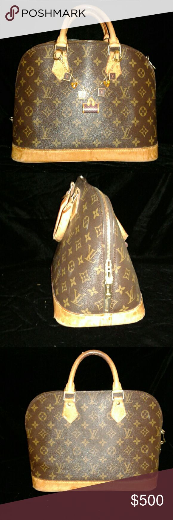 Authentic LOUIS VUITTON ALMA BAG3 Authentic Louis vuitton Alma bag in good condition with some wear to the straps and bottom 2 corners.Very clean inside and out. Louis Vuitton Bags