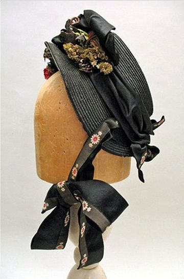 Victorian Black Straw Bonnet with flowers, 1880s.