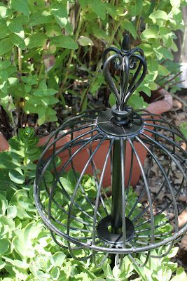 Put two wire baskets together with plastic ties add finial, great garden orb. Dollar tree had some baskets.