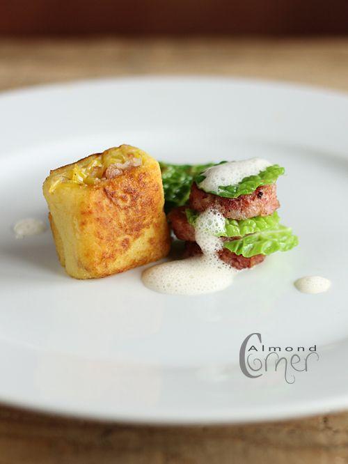 """Almond Corner: Saucisson with leek-bacon """"dumpling"""", Sauerkraut sauce and white cabbage purée"""