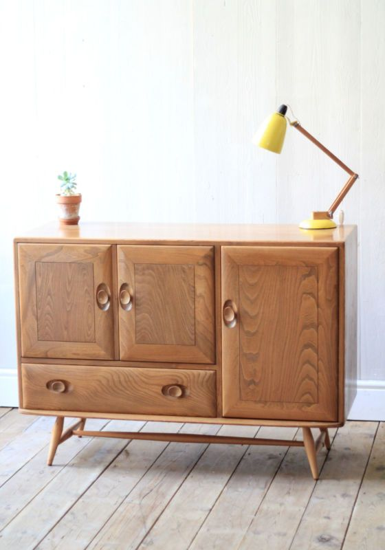 Ercol Sideboard This is a lovely vintage sideboard made by furniture maker Ercol,it is in really good vintage condition overall and would look great in a variety of places around your home. As with any vintage item there is wear and tear and this includes, small marks,scuffs and scratches to the inside and out. Overall very clean for age though