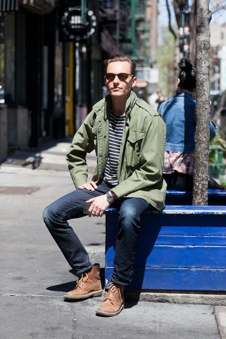 Shop this look on Lookastic:  https://lookastic.com/men/looks/military-jacket-crew-neck-t-shirt-skinny-jeans-boots-sunglasses-watch/10099  — Dark Brown Sunglasses  — Olive Military Jacket  — Navy and White Horizontal Striped Crew-neck T-shirt  — Silver Watch  — Navy Ripped Skinny Jeans  — Tan Suede Boots