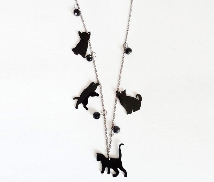Perfect for all cat lovers, this piece consists of four playful silhouettes of a cat, cut from 3mm thick black acrylic. They measure over an inch and are suspended onto a 24 inch oxidised belcher chain with black crystal ball embellishments in between.  Your purchase will be gift wrapped ready for giving or as a treat for yourself.