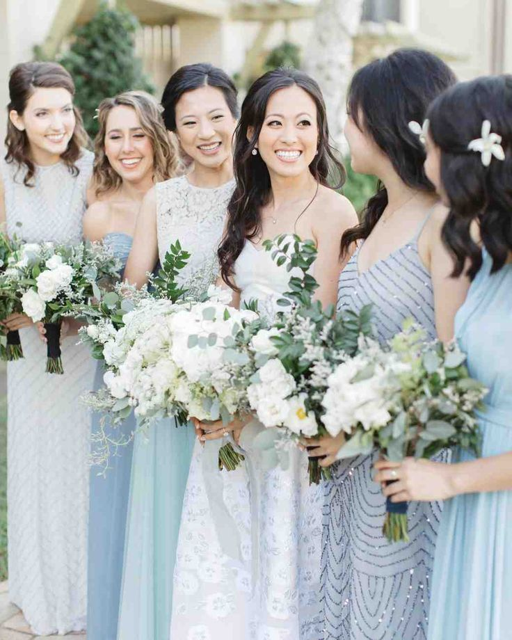 20 Blue Color Wedding Palettes We Love | Martha Stewart Weddings - Committed to wearing white on your wedding day? Pass the blue wedding dress idea onto your bridesmaids, instead. Opt for mismatched bridesmaid dresses that hit multiple points on the color's spectrum, like robin's egg, aqua, and cerulean. #weddingdresses #bridesmaiddresses #weddingideas