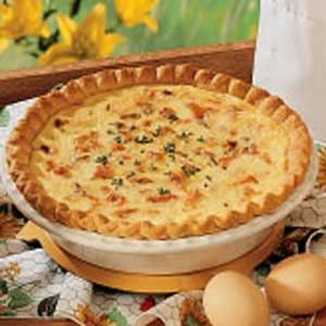 Salmon Quiche  Ingredients  1 unbaked pastry shell (10 inches)  1 medium onion, chopped  1 tablespoon butter  2 cups (8 ounces) shredded Swiss cheese  1 can (14-3/4 ounces) salmon, drained, flaked and cartilage removed  5 eggs  2 cups half-and-half cream  1/4 teaspoon salt  Minced fresh parsley, optional